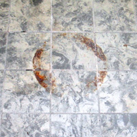 Remove rust stains from marble tiles
