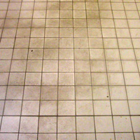 Remove buildup from tile flooring - before